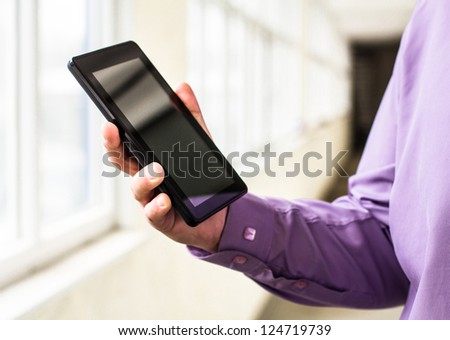 A man holds up and running on a Tablet PC