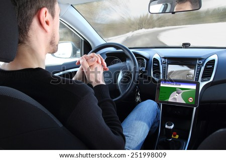 A man in a Autonomous driving  test vehicle