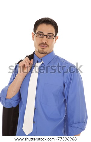 A man in a blue shirt holding his suit jacket over his shoulder. - stock photo