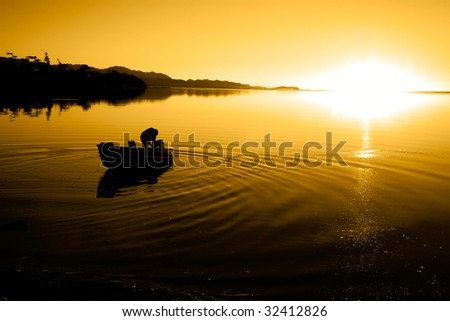 A man in a boat at Cline Spit in Sequim Washington.