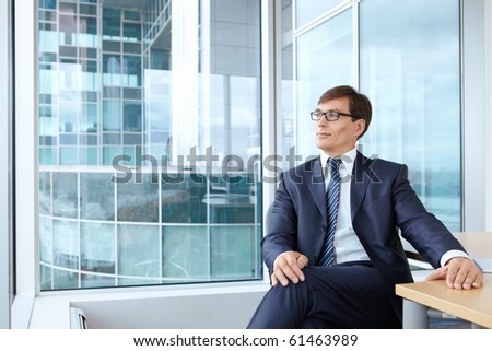 A man in a business suit at the office