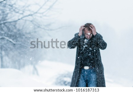 a man in a leather coat covered in snow - Shutterstock ID 1016187313
