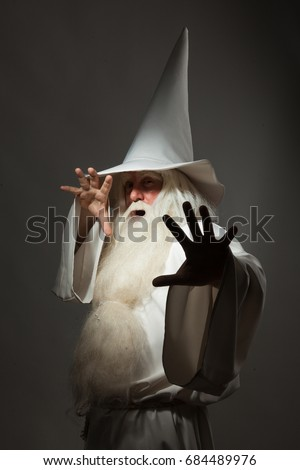 A man in a sorcerer costume on a black background Сток-фото ©