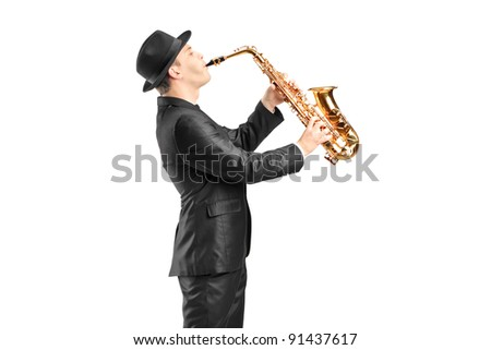 A man in a suit playing on saxophone isolated against background