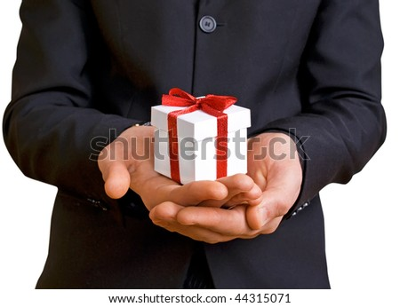 a man in a suit with a gift
