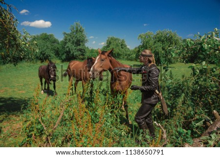 A man in an ancient leather costume knight from fantasy games with horses in the woods & Free photos Medieval knight ride a horse | Avopix.com