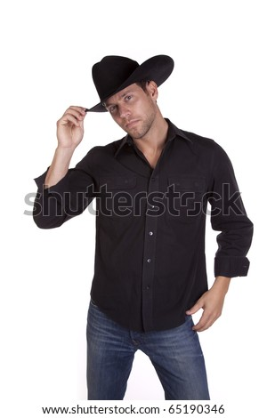 a man in his black cowboy hat tiping it with his fingers saying hello.