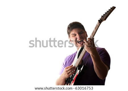 A man in his late teens rocks out while playing his electric guitar.