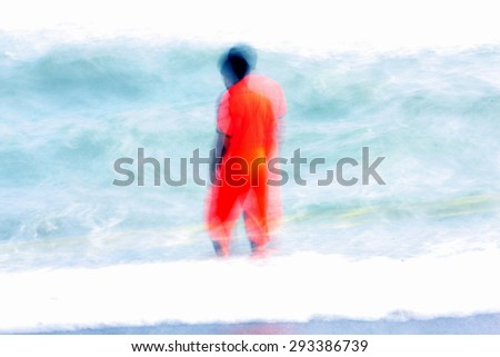 A man in orange suit