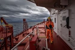 A man in ship's fire outfit on board a vessel