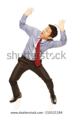 A man in shirt and tie acting afraid of being crushed on white background