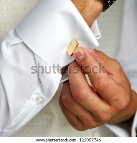 a man in wedding suit preparing his look