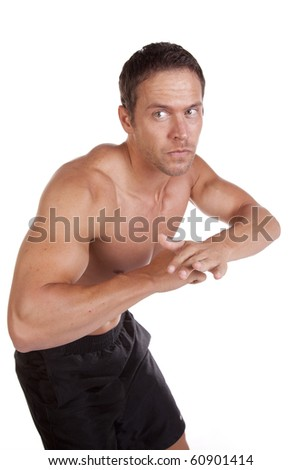 A man is fighting and defending with elbow. - stock photo