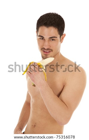 A man is holding a banana ready to eat it with a smile - stock photo