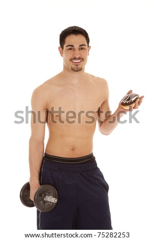 A man is holding a weight in one hand and a donut in the other.