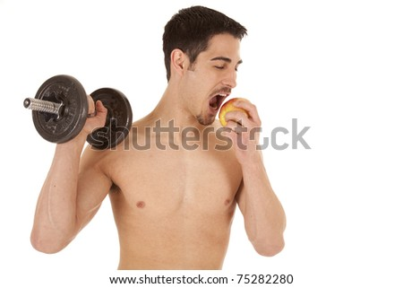 A man is holding a weight in one hand and eating an apple.