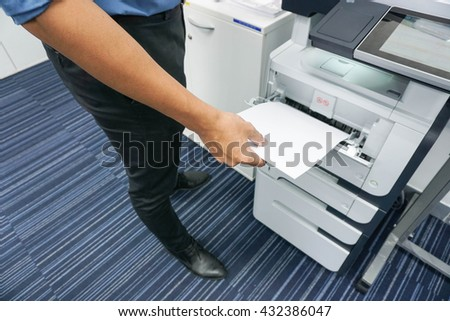 A man is printing document / copy a document