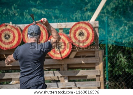 A man is ready for throwing axe on competition.