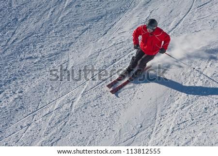 A man is skiing at a ski resort