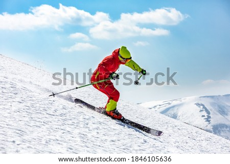 A man is skiing down the hill on the steep slope. High mountain area. Stockfoto ©