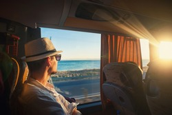 A man is traveling and looking through the bus window during the covid19 corona virus  pandemic