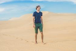 A man is walking in the desert Vietnam, Mui Ne.