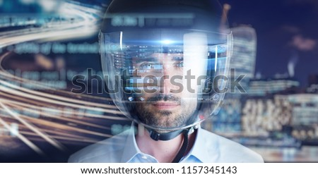 a man is wearing a motorcycle helmet. concept of road future and technology applied to transport.