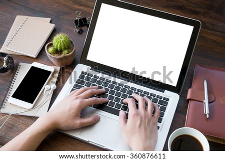 A man is working by using a laptop computer on vintage wooden table. Hand typing on a keyboard. #360876611