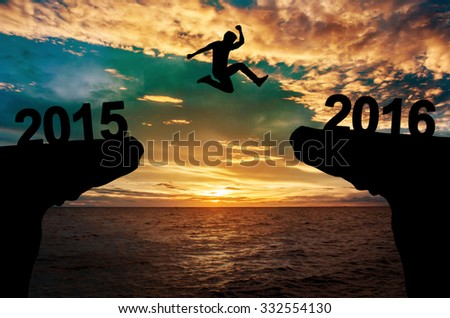 A man jump between 2015 and 2016 years. #332554130