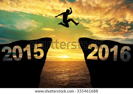 A man jump between 2015 and 2016 years. #335461688