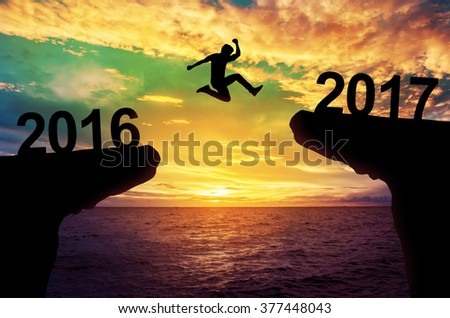 A man jump between 2015 and 2016 years. #377448043