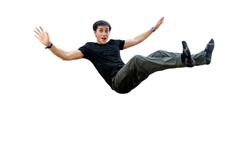 a man jumping on a trampoline and falling isolated