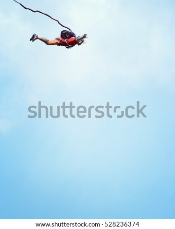 A man jumps from a cliff into the abyss. #528236374