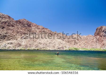 A man kayaking in lake mead