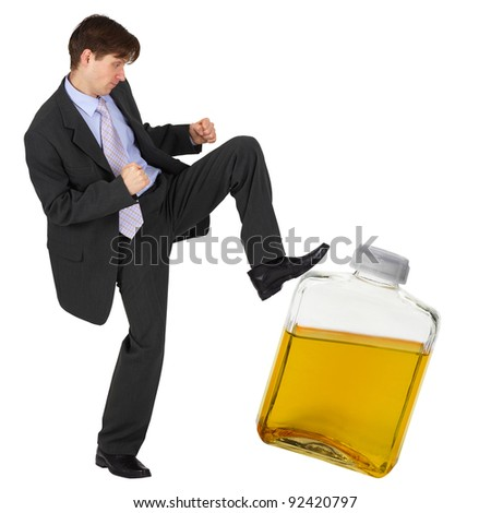 A man kicks a bottle of yellow liquid