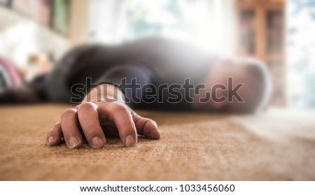 a man lies unconscious in his apartment Stockfoto ©