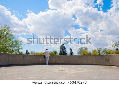 A man looking at the landscape from the outlook