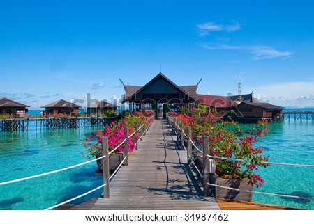A man-made Kapalai island exotic tropical resort in the middle of ocean - stock photo