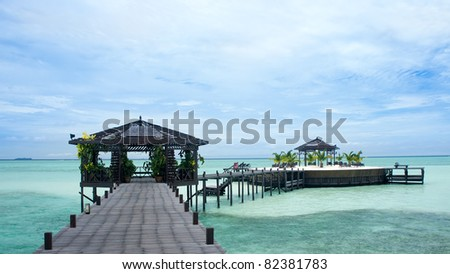 A man-made walkway Kapalai island with exotic tropical resort