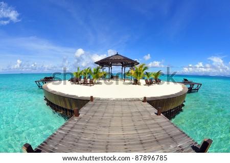 A man-made walkway Kapalai island with exotic tropical resort #87896785