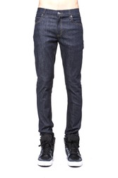 A man(male, boy) stand up wearing black skinny denim pants(trousers, jeans), straight style, running(walking) shoes close up isolated white at the studio.