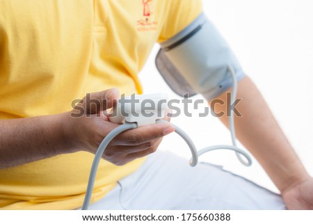 a man measures his blood pressure