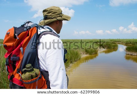 A man observing the wild landscape before him - water and sky