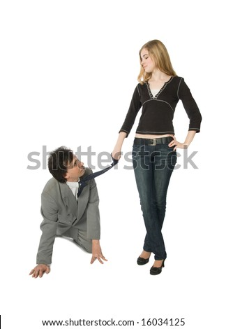 A man on all fours and a young woman pulling him by a necktie