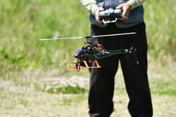 A man operating a radio-controlled helicopter