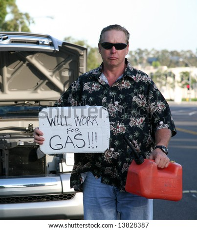 "a man out of gas holds an empty gas can and a ""will work for gas sign"""