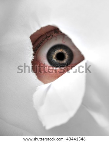 A man peaking through a peice of paper to be a spy.