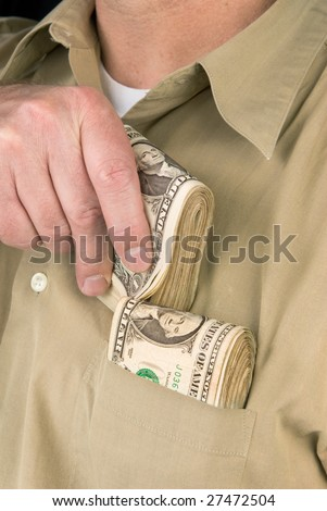 A man places wads of cash into his shirt pocket.  For use with any kind of inference such as drug dealing; gambling; stealing; shopping, etc.