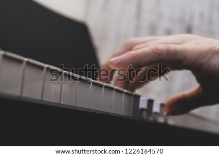 a man playing a keyboard instrument #1226164570