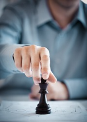 A man playing chess and thinking about a suitable strategy.